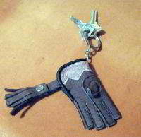 A Mini falconers Glove key chain