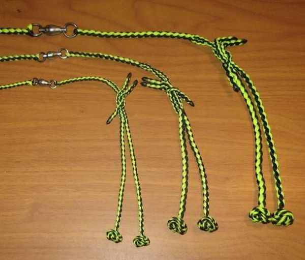 A COMPLETE FOUR STRAND ROUND BRAIDED TETHERING SYSTEM WITH SWIVEL