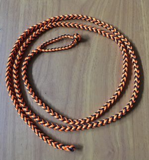 A - EIGHT STRAND ROUND BRAIDED LOOP LEASH – COMES IN THREE SIZES, COLOR IS BLACK AND ORANGE.